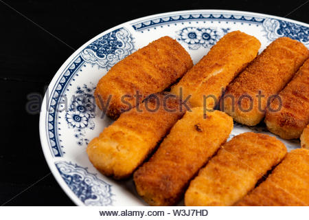 Fried Fish Sticks served on the plate. - Stock Photo