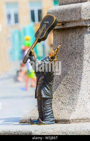 Wroclaw, Poland dwarf gnome with guitar in the old town market square - Stock Photo