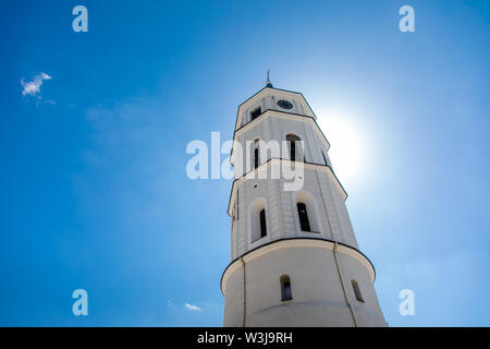 View of bell tower and facade of cathedral basilica of St. Stanislaus and St. Vladislav on Cathedral square. Famous central landmark. Vilnius, Lithuan - Stock Photo