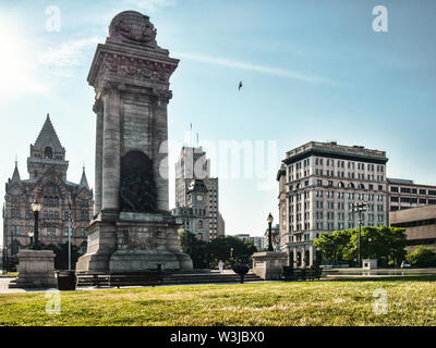Syracuse, New york, USA. July 12, 2019. View of Clinton Square in downtown Syracuse, NY, looking east, with the Soldier's  and Sailor's Monument foref - Stock Photo