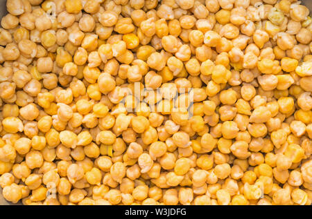 close up of pile of yellow chick peas,pile of cooked kabuli chick peas. - Stock Photo
