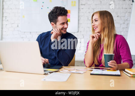 Happy designers working together at office, prototyping new mobile application layout - Stock Photo