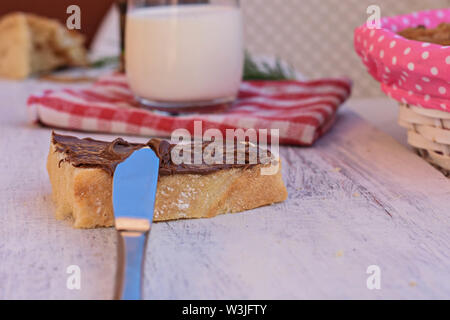 Slice of toasted bread whit chocolate/ nougat cream/ Sweet breakfast - Image - Stock Photo
