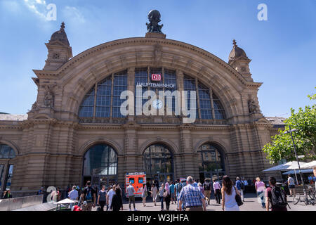 Frankfurt, Germany - July 2019: Frankfurt Main Train station architecture and people around. The railway station has opened in 1899 - Stock Photo