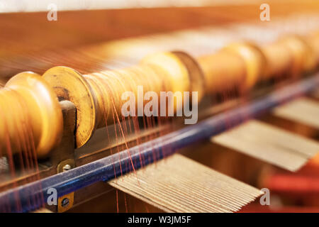 Many spool of threads in a sewing factory. - Stock Photo