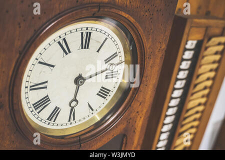 Retro checking-in clock. Used by workers to clock-in and to clock-out. - Stock Photo
