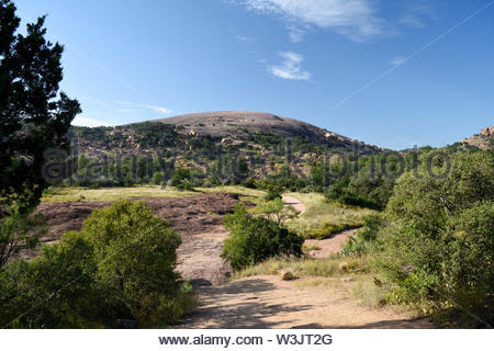 July in Texas. Summer Day at Enchanted Rock State Natural Area in the Texas Hill Country. Hot Summer Day in Texas. West of Austin in the Hill Country. - Stock Photo