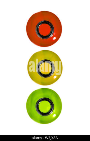 Drunk driving concept. Traffic offense. Drink alcohol behind the wheel. Traffic light from bottles, isolated. Red, yellow and green bottles. - Stock Photo
