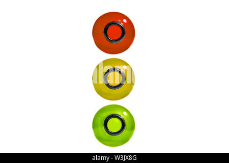 Drunk driving concept. Traffic offense. Drink alcohol behind the wheel. Traffic light from bottles, isolated. Red, yellow and green bottles.