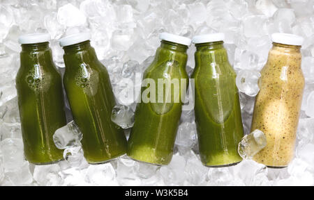 Set of Different detox cocktails in glass jar on ice cubes - Stock Photo