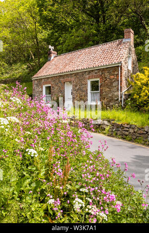 An old stone cottage beside the lane at Petit Bot, Guernsey, UK - Stock Photo
