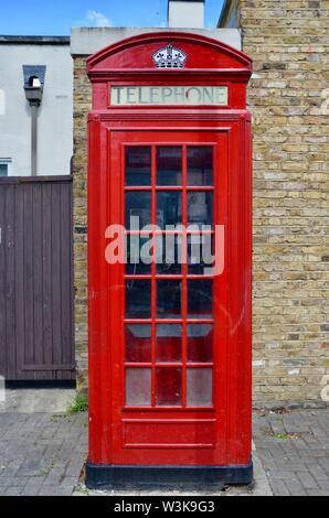iconic red telephone box kiosk in london islington k2 - Stock Photo