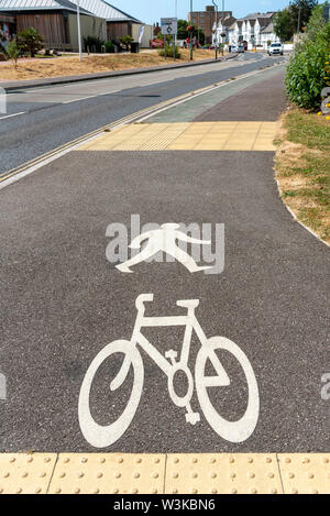 Seaton, Devon, England, UK. July 2019. White painted markings indicating a footpath area for pedestrians and cyclists - Stock Photo