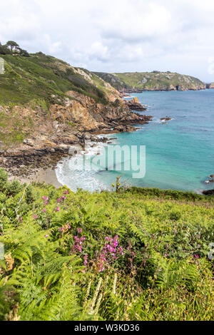 Looking down from the coastal path onto Petit Bot Bay on the beautiful rugged south coast of Guernsey, Channel Islands UK - Stock Photo