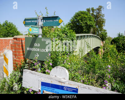 Small Bridge crossing River Thames with Thames Path Sign, nr Old Windsor Lock, - Stock Photo