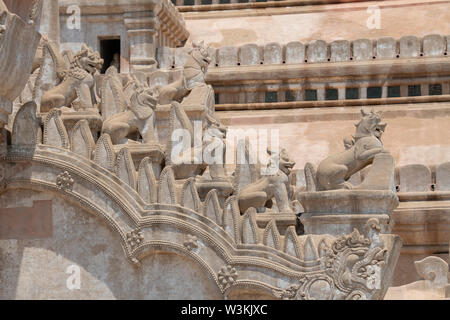 Myanmar aka Burma, Bagan. Ananda Temple aka Ananda Phaya. Buddhist temple built in 1105 AD. Architectural detail of carved exterior. - Stock Photo