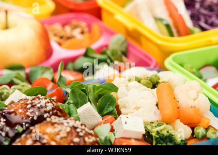 close up view of fresh delicious food in lunch boxes - Stock Photo