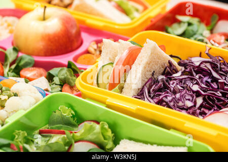 close up view of tasty food in lunch boxes - Stock Photo