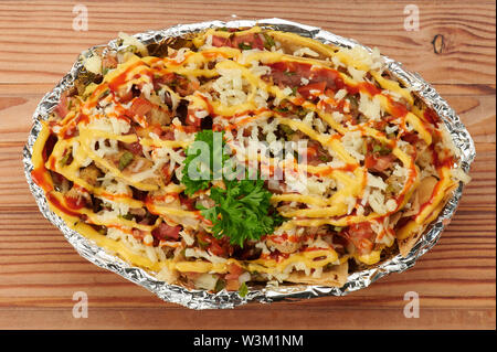 Baked dish with cheese on top in wooden table - Stock Photo