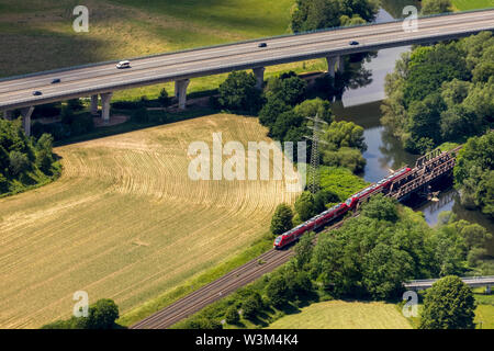 Aerial view of the railway bridge with S-Bahn over the Ruhr and Casparistraße with A46 motorway in Oeventrop in Arnsberg in Sauerland in the state of - Stock Photo