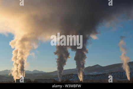 Smoke from factories in Colorado, USA - Stock Photo