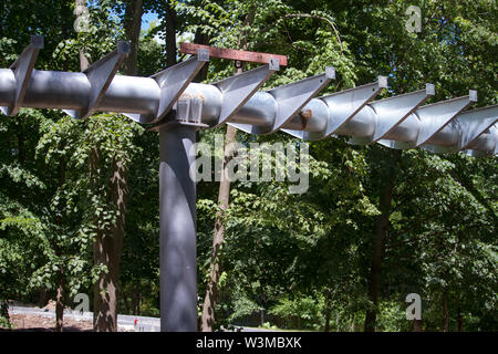 Closeup of metal supports for the construction of a hanging bridge or viaduct in a city park of rest - Stock Photo