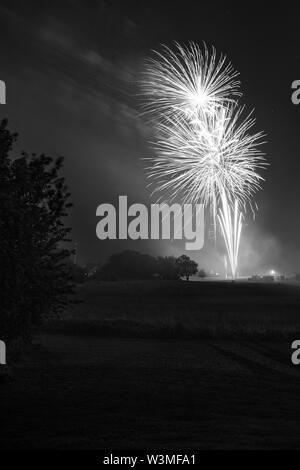 Fireworks going off over Missouri Southern State University in Joplin, Missouri on July 4, 2019 - Stock Photo