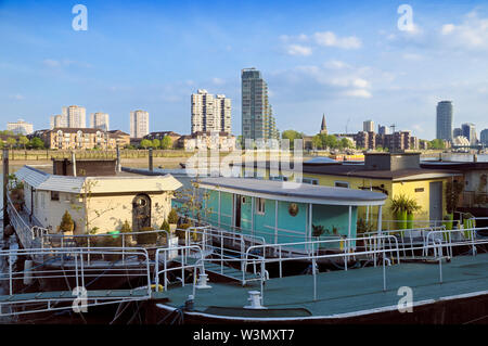 Houseboats on Chelsea Embankment looking across the River Thames towards the Montevetro building and architecture of Battersea skyline, London, UK - Stock Photo