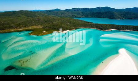 Aerial of Hill Inlet from the air over Whitsunday Island - swirling white sands and blue green water make spectacular patterns - Stock Photo
