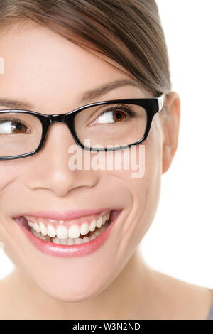 Glasses eyewear spectacles woman looking happy to side with big smile wearing eyeglasses. Close up portrait of female model face isolated on white background. Mixed race Asian Caucasian female model.