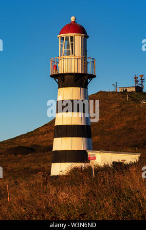 Morning view of Petropavlovsky Lighthouse - oldest lighthouse in Russian Far East (founded in 1850), located on Kamchatka Territory on shore of Pacifi - Stock Photo
