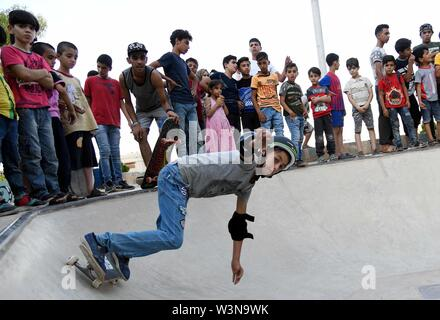 (190717) -- DAMASCUS, July 17, 2019 (Xinhua) -- A boy skateboards during the opening of the first skatepark in Damascus, Syria, July 15, 2019. The skatepark was co-built by SOS Children's Villages in Syria, the German Skate Aid Foundation and Wonders Around the World, an international and independent non-profit organization. The park, which was officially opened on Monday, was completed in 26 days in an abandoned space close to a residential area that witnessed some acts of rebellion in the early years of the eight-year war in Syria. TO GO WITH 'Feature: First skatepark adds new dimension to S - Stock Photo