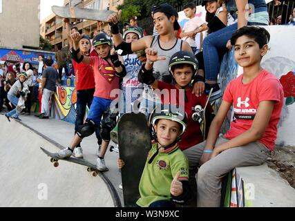 (190717) -- DAMASCUS, July 17, 2019 (Xinhua) -- Children pose for photos during the opening of the first skatepark in Damascus, Syria, July 15, 2019. The skatepark was co-built by SOS Children's Villages in Syria, the German Skate Aid Foundation and Wonders Around the World, an international and independent non-profit organization. The park, which was officially opened on Monday, was completed in 26 days in an abandoned space close to a residential area that witnessed some acts of rebellion in the early years of the eight-year war in Syria. TO GO WITH 'Feature: First skatepark adds new dimensi - Stock Photo