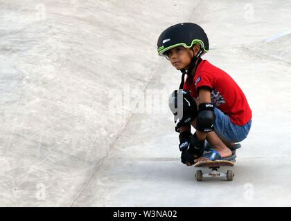 (190717) -- DAMASCUS, July 17, 2019 (Xinhua) -- A child skateboards during the opening of the first skatepark in Damascus, Syria, July 15, 2019. The skatepark was co-built by SOS Children's Villages in Syria, the German Skate Aid Foundation and Wonders Around the World, an international and independent non-profit organization. The park, which was officially opened on Monday, was completed in 26 days in an abandoned space close to a residential area that witnessed some acts of rebellion in the early years of the eight-year war in Syria. TO GO WITH 'Feature: First skatepark adds new dimension to - Stock Photo