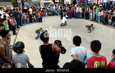 (190717) -- DAMASCUS, July 17, 2019 (Xinhua) -- Young people skateboard during the opening of the first skatepark in Damascus, Syria, July 15, 2019. The skatepark was co-built by SOS Children's Villages in Syria, the German Skate Aid Foundation and Wonders Around the World, an international and independent non-profit organization. The park, which was officially opened on Monday, was completed in 26 days in an abandoned space close to a residential area that witnessed some acts of rebellion in the early years of the eight-year war in Syria. TO GO WITH 'Feature: First skatepark adds new dimensio - Stock Photo
