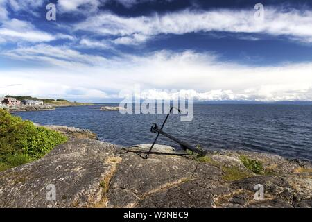 Ship Anchor, Sweeping Landscape Viewand Dramatic Sky over Strait of Juan De Fuca from Saxe Point Park in Victoria BC Canada, Vancouver Island - Stock Photo
