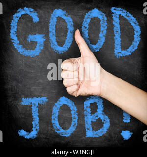 Good job - thumbs up blackboard concept. Close up of woman giving hand sign thumbs up of approval of job well done. Chalk board with GOOD JOB text. - Stock Photo