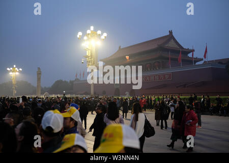 lots of people with cameras and cellphone outside of the forbidden city in beijing at dawn - Stock Photo
