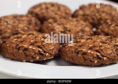 Macro photo of brown dietary low-calorie fitness cereal biscuits with sprinkling closeup on white background. - Stock Photo
