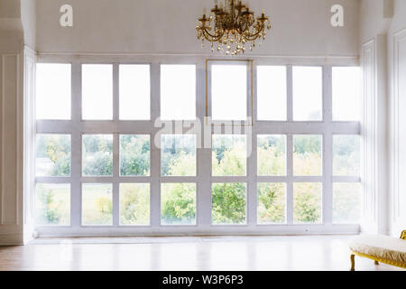 large beautiful white room with windows to the floor - Stock Photo