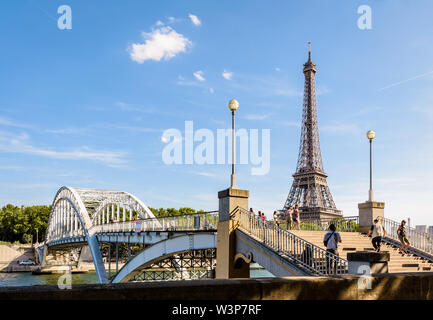 The Debilly footbridge is a pedestrian through arch bridge over the river Seine, built in 1900 not far from the Eiffel tower in Paris, France. - Stock Photo
