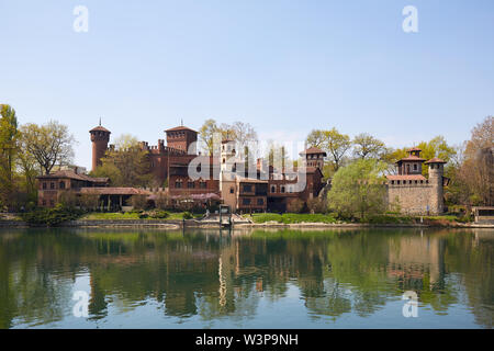 TURIN, ITALY - MARCH 31, 2019: Borgo medievale, medieval village and castle with Po river in a sunny spring day, clear blue sky in Piedmont, Turin, It - Stock Photo