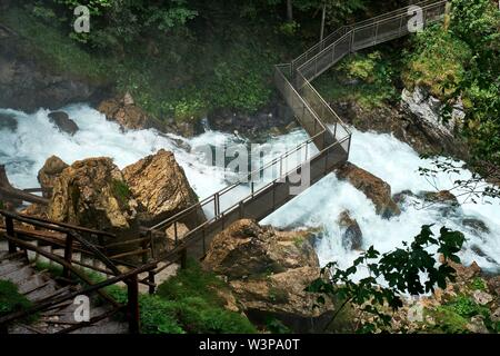 Pedestrian bridge over the Gollinger waterfall, near Golling an der Salzach, Austria - Stock Photo