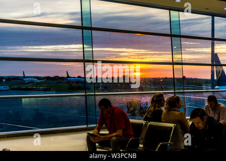 Dublin Airport, Terminal One, Sunrise over the airfield and parked aircraft. Ireland - Stock Photo