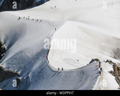 Snow trekking in the mont blanc massif area of the french alps - Stock Photo