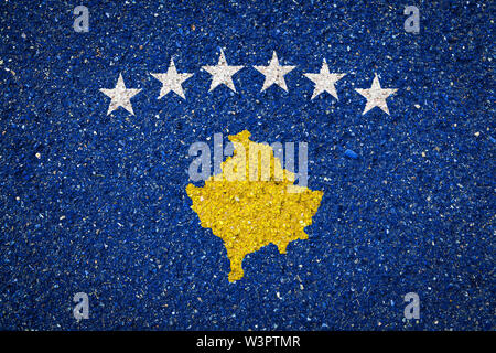 National flag of Kosovo on a stone background.The concept of national pride and symbol of the country. - Stock Photo