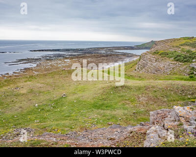 A view of the causeway to Worm's Head on the coast of South Wales - Stock Photo