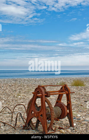 FINDHORN MORAY COAST SCOTLAND IN SUMMER OLD RUSTED CABLE WINCH ON THE BEACH - Stock Photo