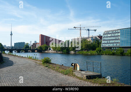 24.06.2019, Berlin, Germany, Europe - View of new buildings on the banks of the Spree River in the Friedrichshain-Kreuzberg district. - Stock Photo
