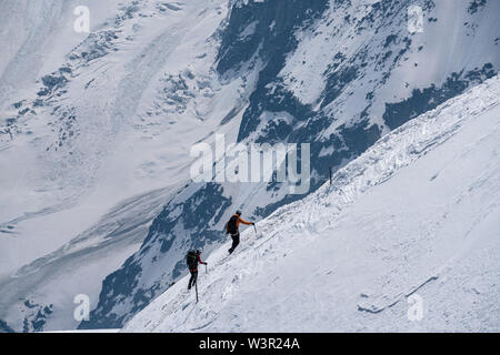 Mountaineers returning to Aiguille du Midi on sunny summer day in Chamonix, France - Stock Photo